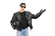 Young biker gesturing with his hand