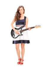 Fashionable woman holding an electric guitar