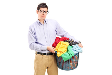 Terrified young man holding a laundry basket