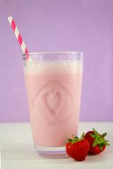 Strawberry milkshake on purple background