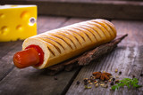 French hot dog grill on wooden surface