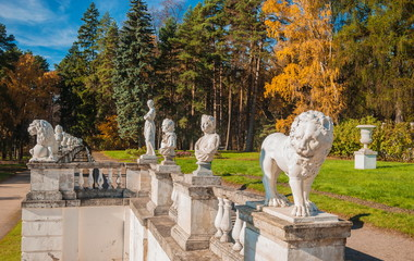 Antique sculptures on the terrace in the autumn park