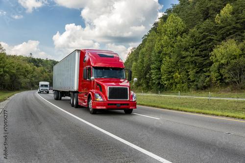 Leinwandbild Motiv Red Semi Truck On An Interstate Highway