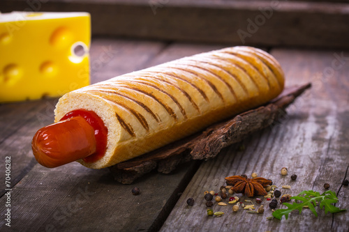French hot dog grill on wooden surface - 70406282