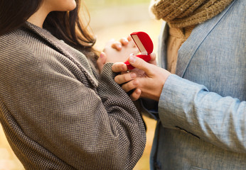 close up of couple with gift box in park