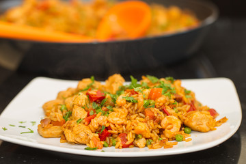 Paella on a plate, still steaming
