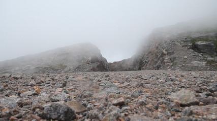 air stream of fog through mountains. polar circle