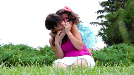 Mother and daughter playing together on grass