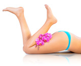Fototapety beautiful legs and orchids - feet in up