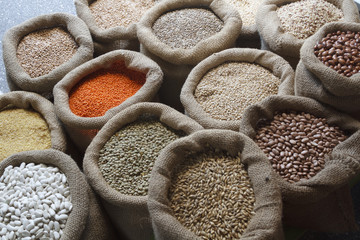 Beans, rice, lentils, oats, wheat, rye and barley in jute sack