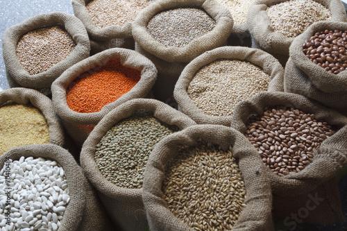 Plexiglas Granen Beans, rice, lentils, oats, wheat, rye and barley in jute sack