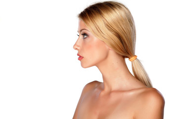profile of a young blonde on white background