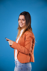 Young businesswoman with her smartphone