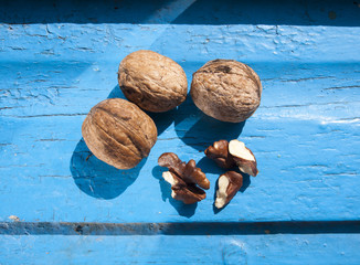 Nuts on blue wooden background