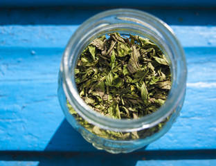 Close up of dried mint in a jar