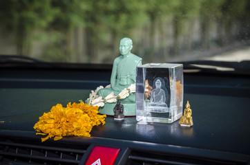Crystal statue buddha in car