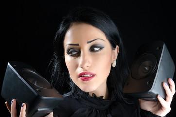 Girl Holding Audio Speakers