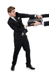 Businessman Snatching Briefcase From Partner