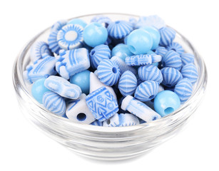 Beads in glass bowl isolated on white