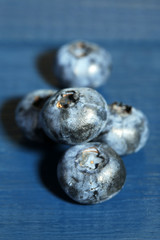 Tasty ripe blueberries, on wooden background