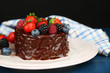 Tasty chocolate cake with different berries
