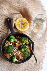 A healthy meal broccoli salad with bacon and roasted almonds