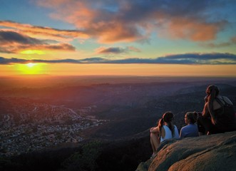 Hikers Watching a Colorful Sunset over San Diego, California