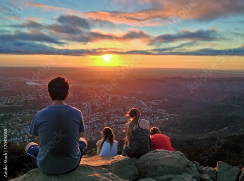 People Watching a Colorful Sunset over San Diego, California