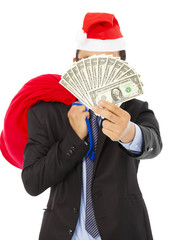 business man holding a christmas gift bag and money