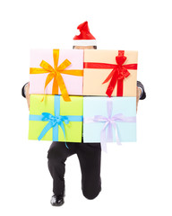 Businessman holding gifts and kneel down .