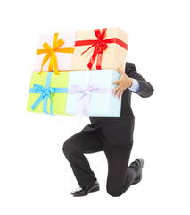 Businessman holding gifts and kneel down . isolated on white