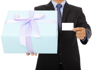 Businessman holding a gift box and a card.