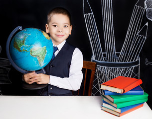 schoolboy with a globe