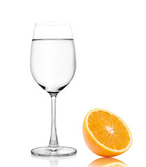 Glass of water and Half orange fruit on white background, fresh
