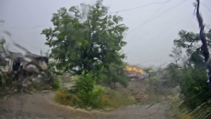 Looking at storm heavy rain out of window
