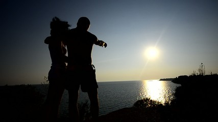 Couple hugging and kissing At Sunset