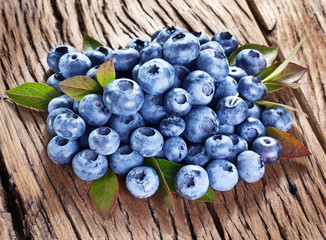 Blueberries over old wooden table.