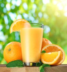 Orange fruits and glass of orange juice.