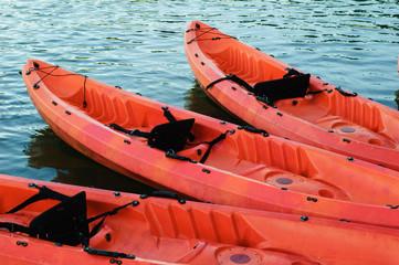 red kayaks on dark water