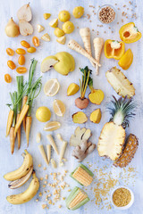 Variety of yellow toned fresh produce fruits and veg