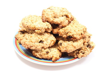 Oatmeal cookies with raisins on colorful plate