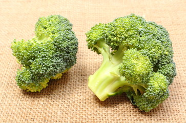 Portion of fresh green broccoli on jute canvas