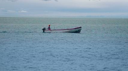 Fishing boat on sea horizon