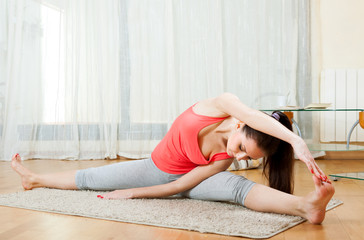 girl doing exercises of  yoga