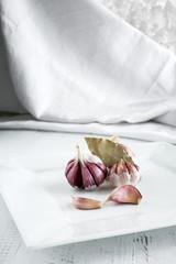 Garlics on wooden board