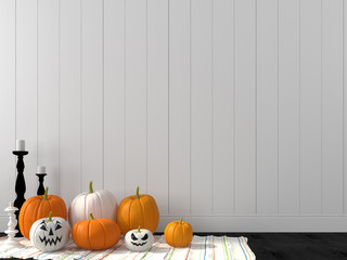Funny pumpkin against a white wall