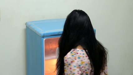 Woman open empty fridge