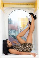 woman sitting on the windowsil