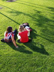 Young women sitting on the grass