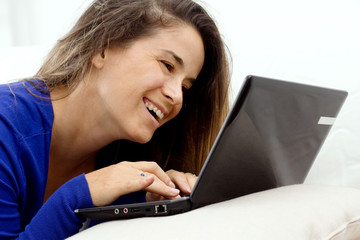 smiling girl at laptop
